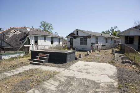 blighted: After hurricane Katrina passed the city of New Orleans the levees failed flooding most of New Orleans. Hardest hit was the Ninth Ward seen here. In this picture a home sits 20 feet off its foundation. Adjacent homes are also destroyed. One block behind f