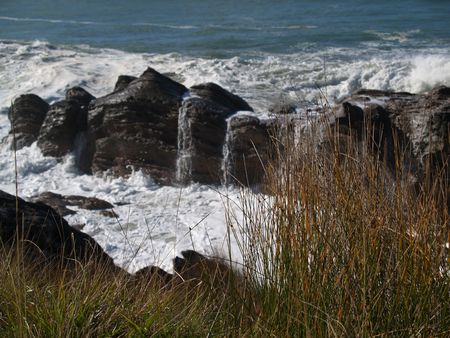 Waves break over rock outcrop. Stock Photo - 4797784