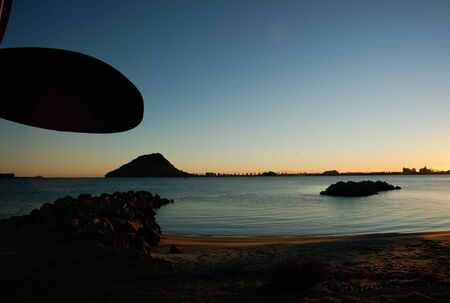 Just before sunrise, silhouette of propeller blade adds a nautical feel to view across Tauranga Harbour to Mount Maunganui. Stock Photo - 7352448