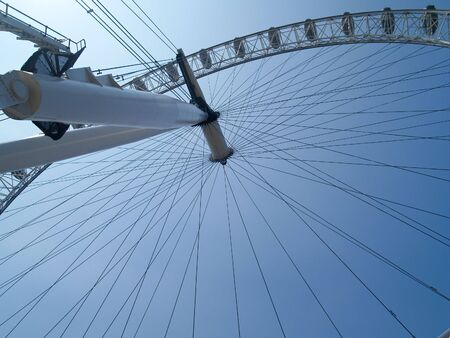 London, England, July 3 2009, London eye, or Millennium Wheel looking from below into the sun.