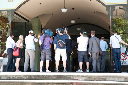 SYDNEY, AUSTRALIA - JANUARY 25: The press gather outside court waiting for subject of hearing to emerge on January 25 2011. High profile court cases create much press interest.