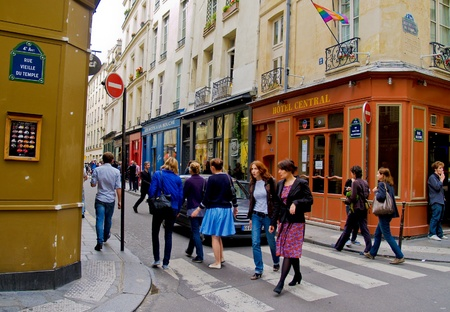 rue: PARIS, FRANCE - JUNE 21, 2009: People going about their business on a typical Paris street, Rue Vieille du Temple