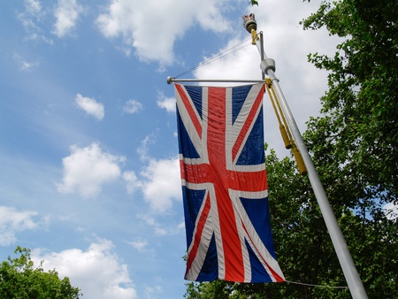 Union Jack hangs from a pole on the Mall, London  Stock Photo