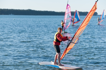 Tauranga, New Zealand - May 3, 2012, Students learn to windsurf on Tauranga harbour. Editorial