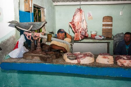 PINAR DEL RIO - CUBA - JULY 3, 2012- meat shop on side of road. Would not pass food and safety regulations in a western country.