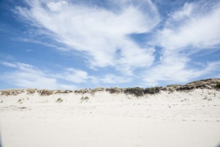 cloud formation: Cloud formation over sand dune