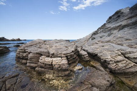 rock formation: Volcanic coastal rock formation. Stock Photo