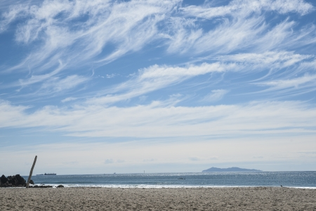 Wispy clouds over Mount Maunganui beach, New Zealand
