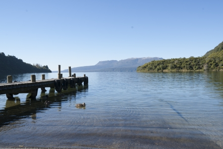 Jetty on Lake Tarawera, with the volcanic mountain on horizon, site of the archaelogic Pink and White Terraces