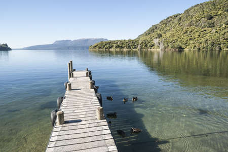 extends: Jetty extends into lake  Stock Photo