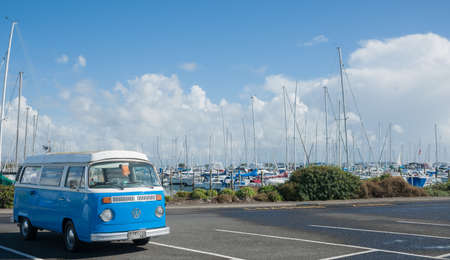 Tauranga, New Zealand, JAugust 17, 2013; Blue and white retro VW ombi van parked at marina