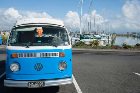 vw: Tauranga, New Zealand, JAugust 17, 2013; Blue and white retro VW ombi van parked at marina