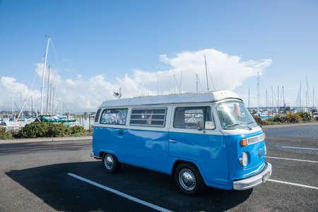 campervan: Tauranga, New Zealand, JAugust 17, 2013; Blue and white retro VW ombi van parked at marina