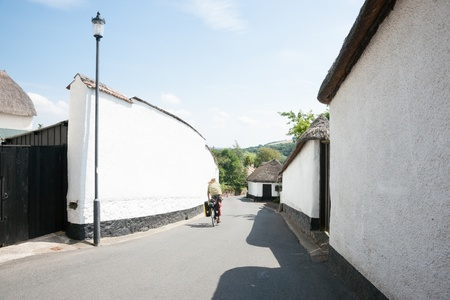 Narrow village lane with high white walls  photo