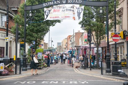 east end: London, England; Entrance to the famous Roman Road Street Market held every summer Saturday