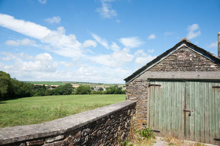 land locked: Typical English countryside with stone shed and fence in foreground