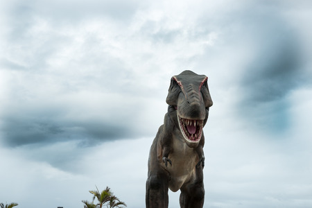Dinosaur bearing down with stormy sky  Stock Photo