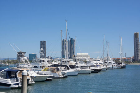 neighbouring: Marina at Surfers Paradise on Australia s Gold Coast, with commercial skyline of neighbouring Southport in background