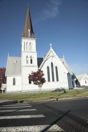 Landmark White church built in 1881 with pedestrian crossing in Cambridge, NZ
