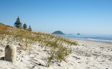 View along a stunning beach towards Mount Maunganui