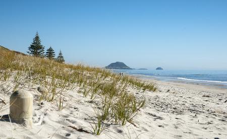 View along a stunning beach towards Mount Maunganui