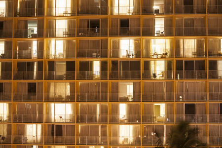 windows: Apartment windows make an architectural abstract at night. Stock Photo