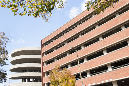 carpark: Modern architecture, the diminishing perspective of floors of a carpark building with circular entrance ramp