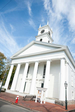 cape cod style: Traditional white church on street corner. Stock Photo