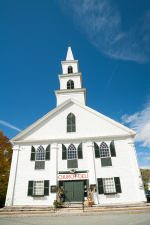 NEWFANE, USA - OCTOBER 11, 2014; small white church on market day, example of greek revival architecture in Newfane Historic District, USA