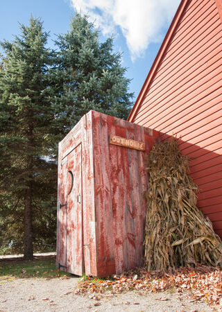 outhouse: Old outhouse on end of building