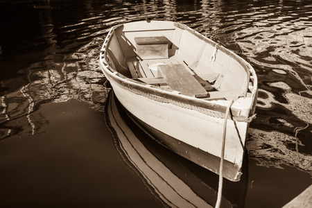 coiled rope: Old style dinghy and image. Stock Photo