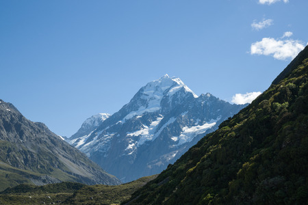 remoteness: Mountain scenery, silhouette slopes with distant Mount Cook, New Zealand. Stock Photo