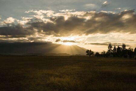 moody sky: Benmore Range, and dark moody sky, Omarama, Central Otago at sunrise.