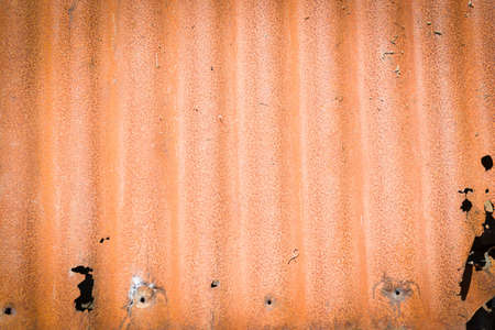 rusting: Old iron, rusting corrugated iron, close up with vignette, background