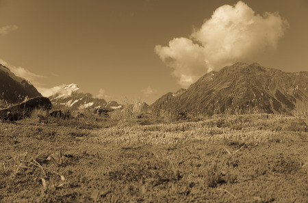 tearing down: South Island landscape in sepia. Old style image of Hooker Valley, Aoraki-Mount Cook National Park, New Zealand.