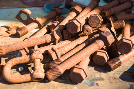 rusting: Old bolts, left lying in a group, rusting and unwanted. Stock Photo