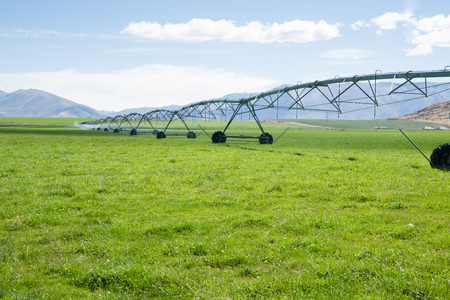 moveable: Irigation system, long moveable booms of the water distribution plant stretches across farming fields on Otago, New Zealand.