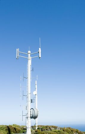 telecommunications industry: Mobile Communications tower on Bluff Hill, South Island, New Zealand stands against clear blue sky.