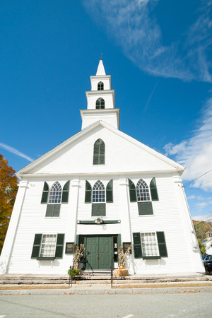 Traditional style 18th century white wooden church with green window shutters, Newfane, Windom County, Vermont, USA. Original church charter holder was Luke Knowlton, photo