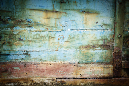 fade away: Abstract closeup of old abandoned ships hull, veteran flat-bottomed scow �Portland�moored in the Owaka River