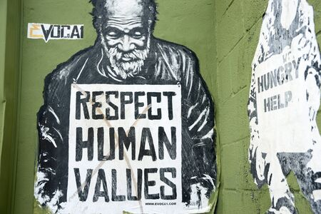 destitute: Miami, Florida, USA - June 28, 2012: Respect human values street art  image of destitute man with sign pleading for respect for the needy in Wynwood, Miami. Editorial