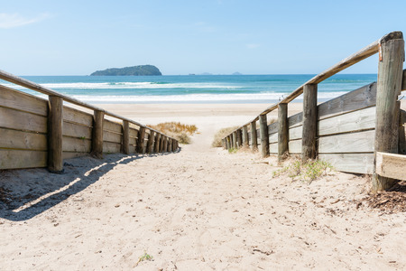 new zealand beach: Sand path leading to Pauanui Beach New Zealand