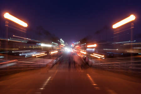 street shot: Street motion, urban magical glowing blurred out of focus night shot  background street  lights effect. Stock Photo