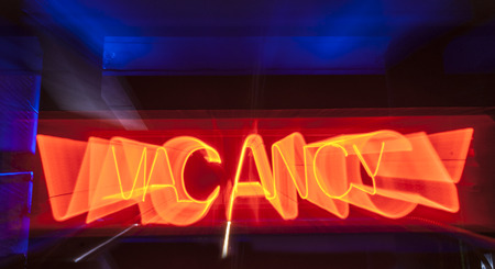 vacancy: red neon vacancy sign for motel.