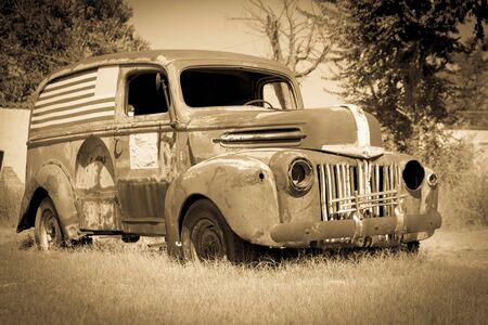 rusting: Old American van deserted rusting away