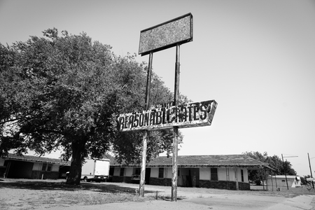 unloved: Abandoned and desolate example of deteriorating real estate when no longer economic in Erick Oklahoma USA Editorial