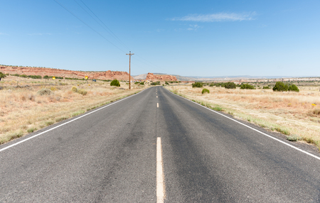 straight road: Long straight road ahead through desert of New Mexico, USA. Stock Photo