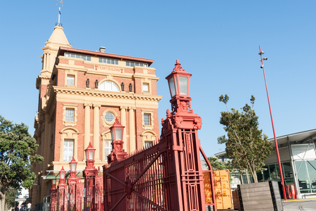 edwardian: Auckland New Zealand December 26, 2015- Auckland historic Edwardian Baroque architectural style with red wrought iron gates of Ferry Building on city waterfront. Editorial