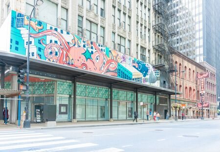 adams: Chicago, USA - August 29,2015; Street art in downtown Chicago old buildings and historic Berghoff restaurant neon sign on West Adams Street, whichs opened in 1898 has become a Chicago landmark