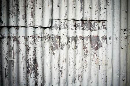 corrugated iron: Vignette background corrugated iron rough and peeling paint